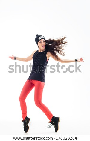 young beautiful dancer posing on studio background - stock photo