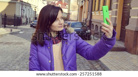 young,beautiful,dark-haired girl makes selfi