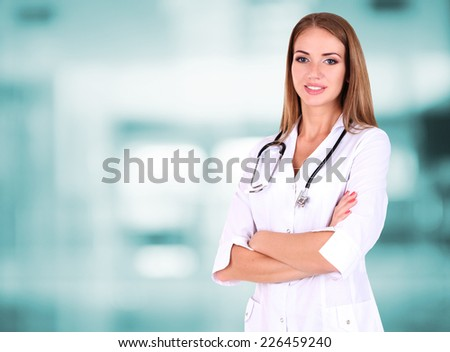 Young beautiful doctor on hospital background - stock photo
