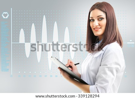 Young beautiful doctor with clipboard and cardiogram - stock photo