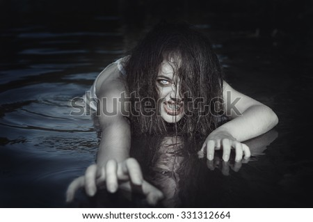 Young beautiful drowned ghost woman in the water outdoor - stock photo