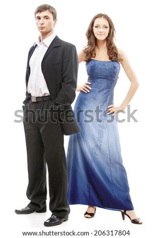 Young beautiful elegant couple - man in suit with woman in blue dress. - stock photo