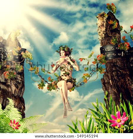 Young beautiful fairy woman playing the flute while sitting on a swing in the chain between the rocks and leaves - stock photo