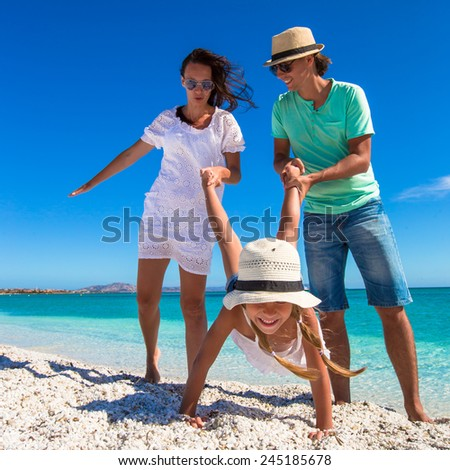 Young beautiful family have fun on tropical vacation - stock photo
