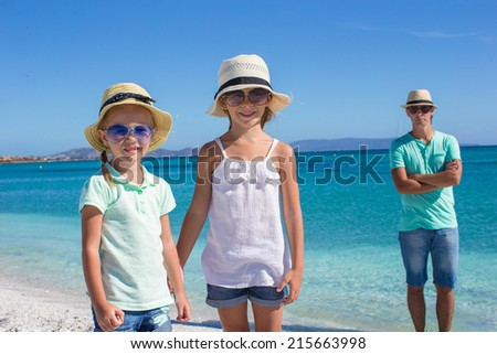 Young beautiful family of three on tropical vacation - stock photo