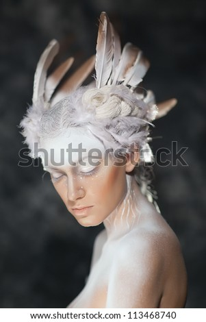 Young beautiful fashion model with creative makeup close-up portrai.White Swan, the ballet.Halloween - stock photo
