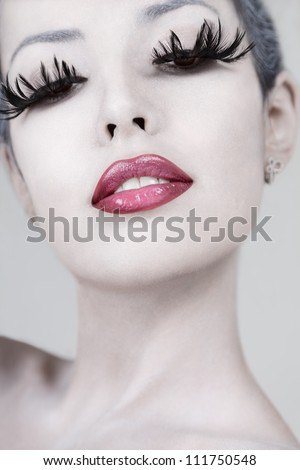 Young beautiful fashion model with creative makeup close-up portrait - stock photo