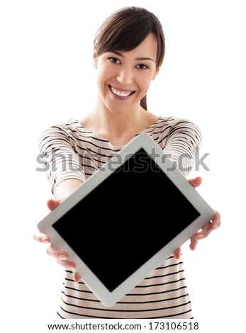 Young beautiful female holding and showing tablet and smiling  - stock photo