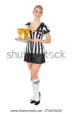 Young Beautiful Female Referee Holding Tray With Beer Over White Background - stock photo