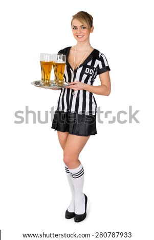 Young Beautiful Female Referee Holding Tray With Beer Over White Background