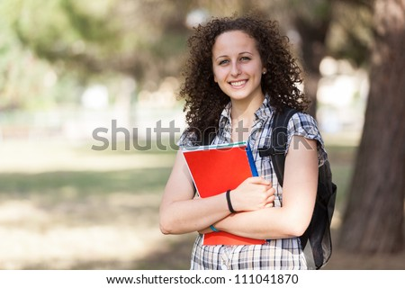 Young Beautiful Female Student at Park - stock photo