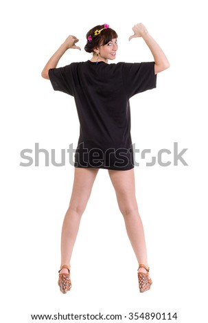 young beautiful female with blank black t-shirt isolated on white background in full length. - stock photo