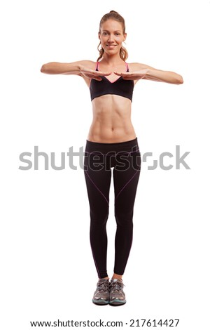 Young beautiful fitness girl doing exercise isolated on white