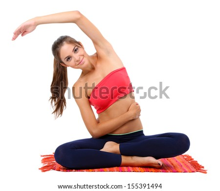 Young beautiful fitness girl doing yoga exercise isolated on white - stock photo