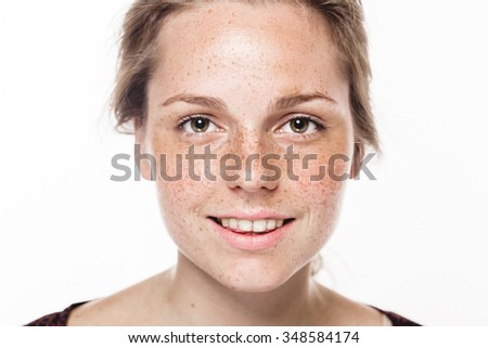 Young beautiful freckles woman face portrait with healthy skin - stock photo