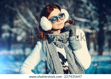 Young beautiful girl are in the winter forest. winter theme