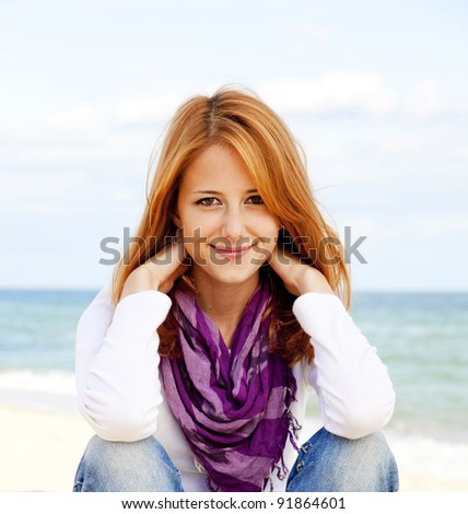 Young beautiful girl at the beach. - stock photo