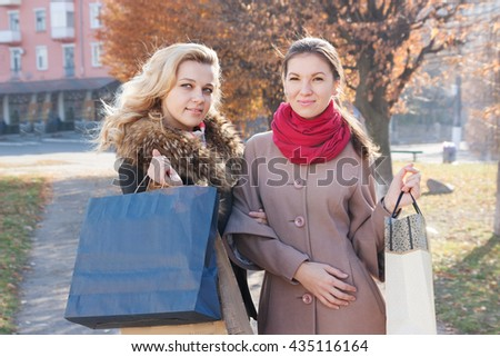 Young beautiful girl brunette and blonde  with shopping