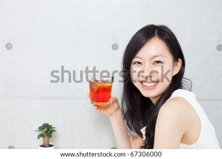 Young beautiful girl drinking tea in a cafe