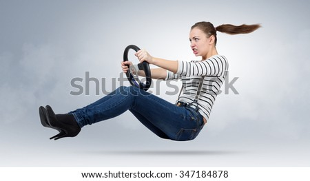 Young beautiful girl driver car with a wheel, auto concept - stock photo