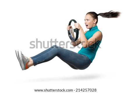 Young beautiful girl driver with a wheel on white background, auto concept - stock photo
