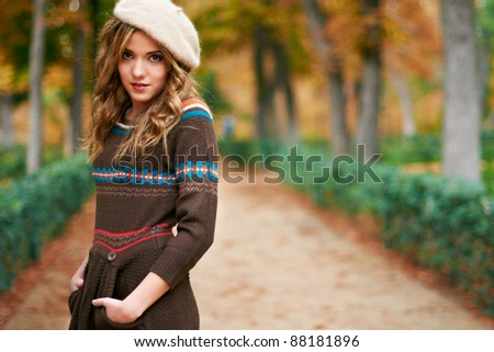 Young beautiful girl fashion shot / Autumn scene - stock photo