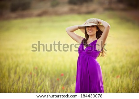 Young beautiful girl feeling freedom on meadow - stock photo