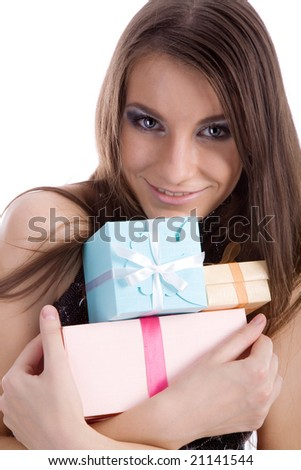 Young beautiful girl holding festive boxes firmly