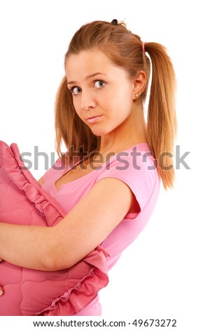 Young beautiful girl holds pink pillow, it is isolated on white background.