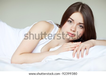young beautiful girl in a bed - stock photo