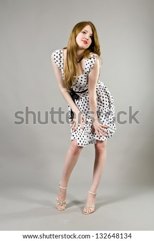 Young beautiful girl in a dress with black peas - stock photo