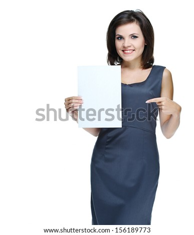 young beautiful girl in a gray business dress, holding a poster and shows a finger at him.Isolated on white background