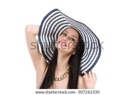 young beautiful girl in a hat going to the beach