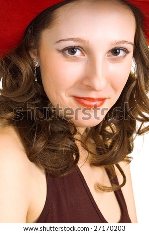 young beautiful girl in a red hat on white - stock photo