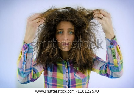 Young beautiful girl in a shirt with tousled hair - stock photo