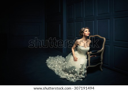 Young beautiful girl in a white dress - stock photo