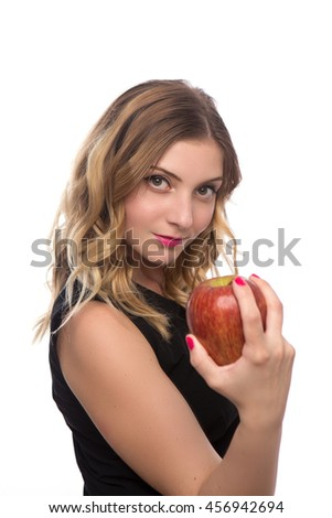 young beautiful girl in black dress with Apple in hands isolated on white background - stock photo