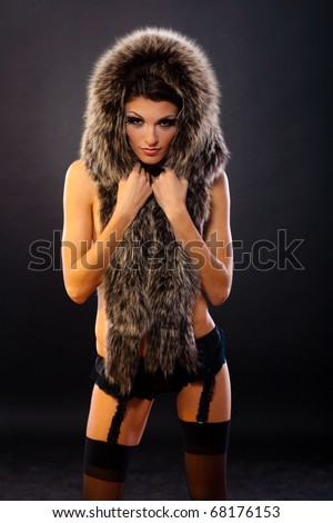 Young beautiful girl in lingerie with fur