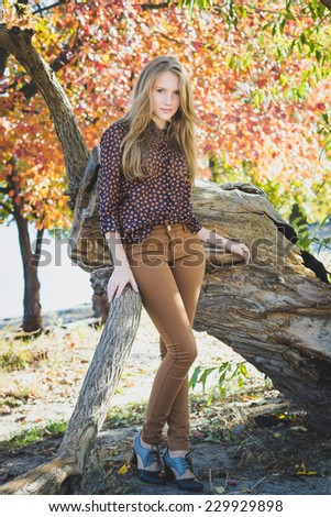 Young beautiful girl in park, full-length portrait   - stock photo