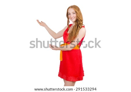 Young beautiful girl in red dress pointing isolated on white - stock photo
