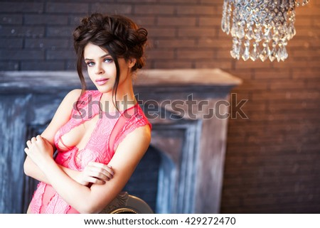Young beautiful girl in red underwear - stock photo
