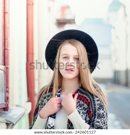 Young beautiful girl in the black hat