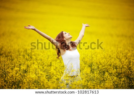 young beautiful girl in the field