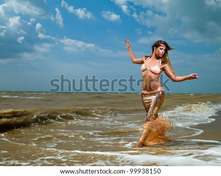 Young beautiful girl in the image of a mermaid - stock photo