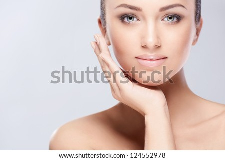Young beautiful girl in the studio - stock photo