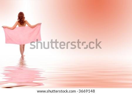 Young beautiful girl in towel in water - stock photo