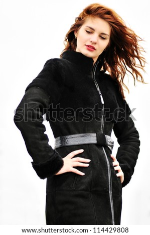 young beautiful girl in windy weather - stock photo
