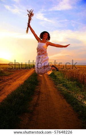 Young beautiful girl jumping - stock photo
