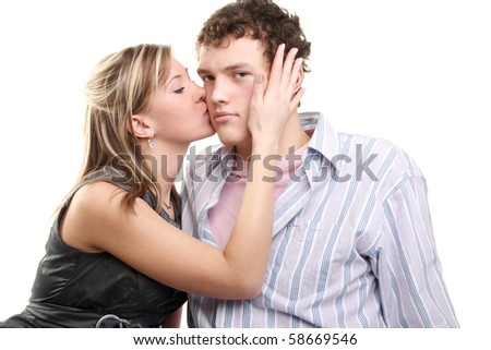 young beautiful girl kissing handsome young man - stock photo