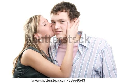 young beautiful girl kissing her boyfriend - stock photo